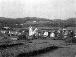Mirna Peč s farno cerkvijo Sv. Kancijana