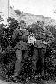 Franc Znidaršič in Franc Lah pri šoli, zadaj kamnolom.